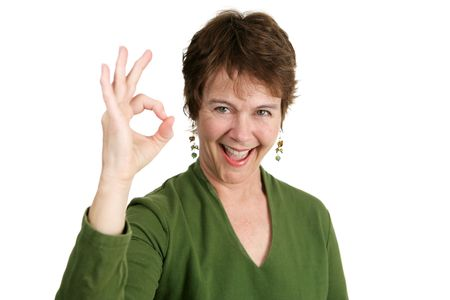 50: An adorable fifty year old Irish woman giving the okay hand sign.   Stock Photo