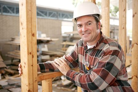 actual: A friendly, smiling construction worker on the job.   Authentic construction worker on actual construction site.   Stock Photo