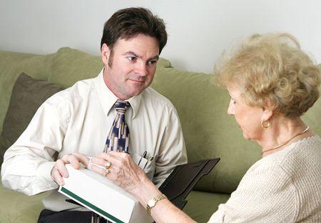 sympathetic: A sympathetic counselor offering an upset client a tissue.