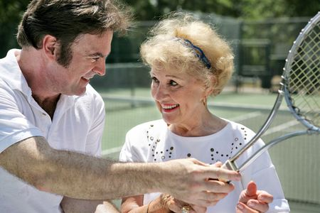 gigolo: A handsome tennis pro gives pointers to a beautiful older lady.