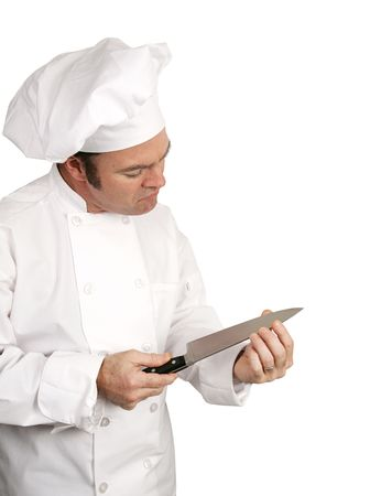 sharpness: A male chef testing the sharpness of his knife blade.  Isolated on white with room for text.