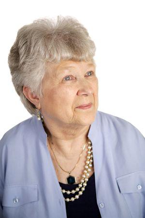Eine hübsche Frau sucht Senior der mit einem Ausdruck der Zufriedenheit. Weißem Hintergrund  Standard-Bild - 1148136