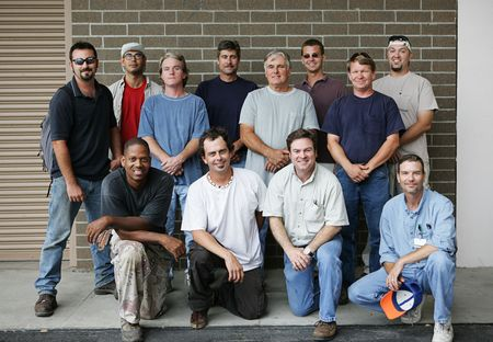 average guy: Technical college class photo of a group of handsome blue collar working men.  Diverse ages and ethnicities represented.