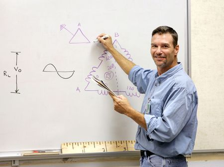 A handsome teacher drawing a mathematical diagram on the white board. photo