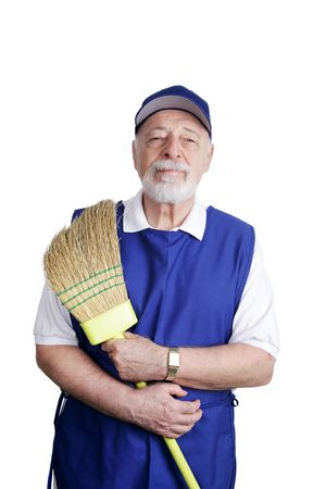 smock: A senior man working at a discount store sweeping up.  Isolated on white.