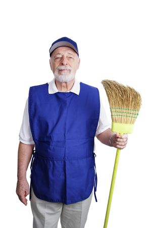 A senior man, unable to retire and working as a janitor at a discount store, posing with his broom. photo