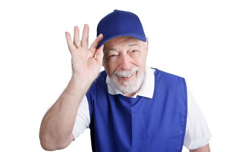 smock: A friendly senior man greeting customers at a discount store.  Isolated on white.