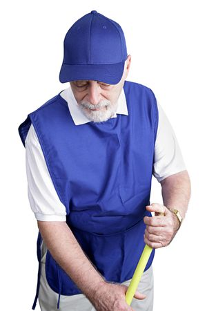 sweeps: A senior man sweeps up on his menial service job. Isolated on white. Stock Photo