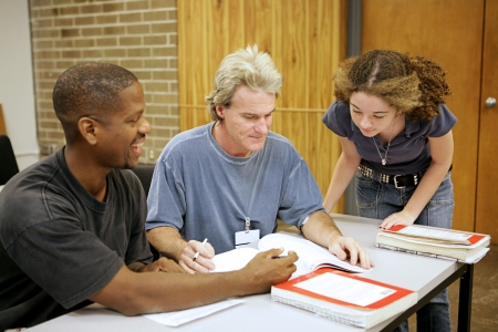 A group of diverse adult education students going over an assignment. Stock Photo - 1413590