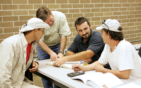 A group of adult education students studying together. Stock Photo - 1414415