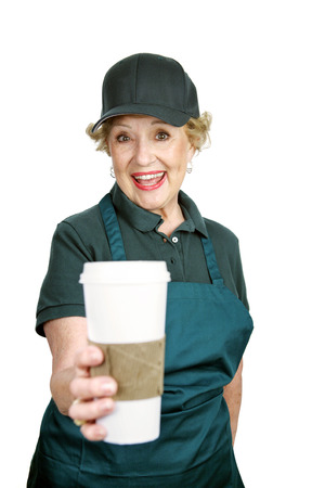 A cute senior lady enthusiastic about her job serving coffee.  Isolated on white. photo