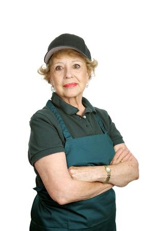 dignidad: Una mujer de alto nivel de servicio haciendo un trabajo con orgullo y dignidad. Aislado en blanco.  Foto de archivo