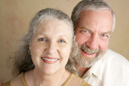 A good looking, gray haired mature couple.  Closeup portrait. photo