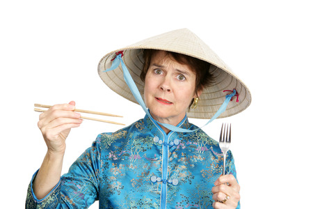 A tourist in Chinatown confused about whether to eat with a fork.  Isolated on white.   photo