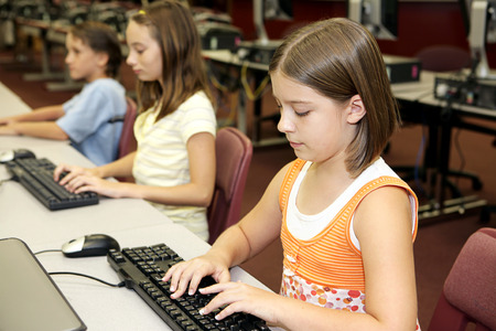 School children learning computers in the library media center. Stock Photo - 1640205