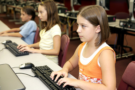 Students in the school library doing research on computers. Stock Photo - 1640207