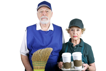 afford: A senior couple stuck in boring service jobs because they cant afford retirement.  Isolated on white.