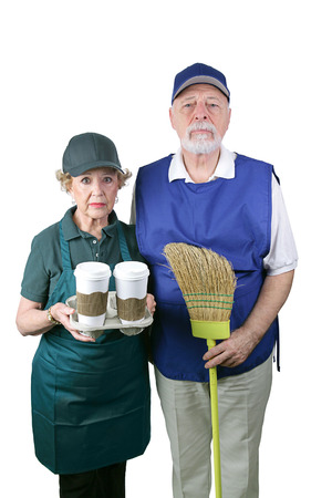 A senior couple unable to retire is working in the fast food and retail industries.  Isolated on white.     Stock Photo