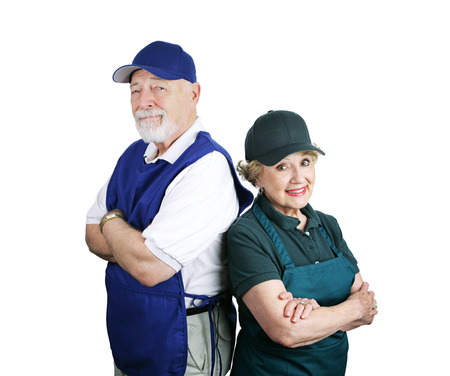 unable: A senior couple unable to retire and working service industry jobs.  Isolated on white. Stock Photo