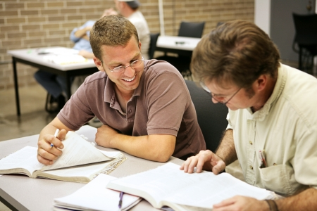 Adult education students studying together in class.   photo