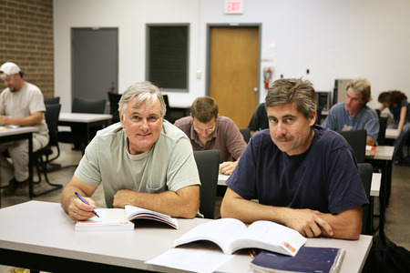 training group: A man in his fifties back at school for job training.   Stock Photo