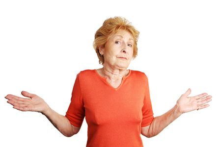 unsure: Pretty red haired senior lady shrugging and throwing up her hands in confusion.  Isolated on white.