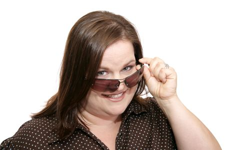 plus sized: Beautiful plus sized model flirting by lowering her sunglasses to check you out.  Isolated on white.