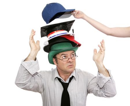 represented: Overwhelmed businessman with more and more responsibility - represented by hats.  Another being added.