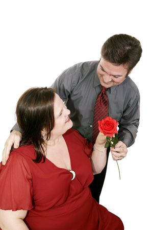 identifies: A man on a blind date identifies himself with a red rose.  Isolated on white.   Stock Photo