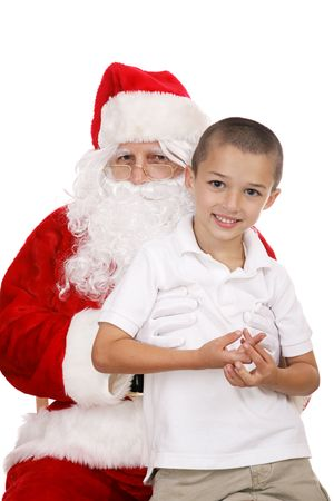 Adorable little boy sitting on Santas Lap.  Isolated on white. photo