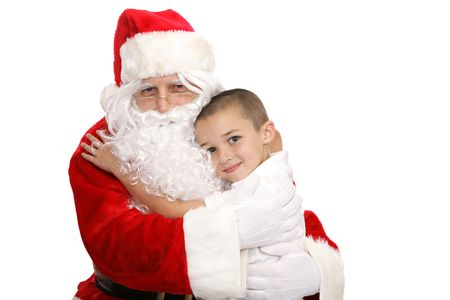 Adorable little boy giving Santa Claus a hug.  Isolated on white. photo