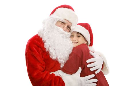Santa giving a hug to an adorable little boy.  Isolated on white.   photo