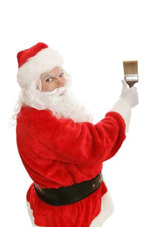 Santa Claus using a 3 inch paintbrush.  Waist up isolated on white.   Stock Photo