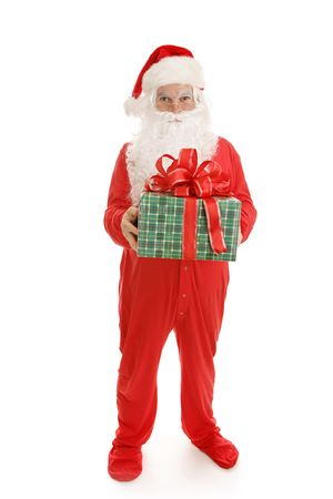 Santa in his footy pajamas ready for bed.  He is holding a wrapped gift.  Full body on white background.   Imagens