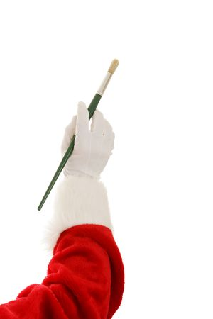 cuffs: Santa Claus hand holding an artists paintbrush.  Isolated on a white background.