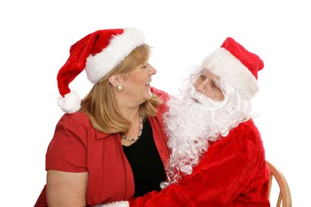 Woman sitting on Santas lap giving him her Christmas wishes.  Isolated on white.   photo