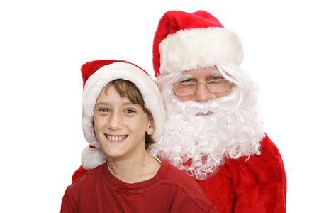 Boy posing with Santa. Isolated on white.   photo