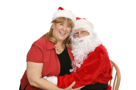 Santa Claus hugging a woman who is sitting on his lap. Isolated on white.   photo