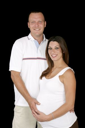 Beautiful young couple expecting a .  Black background. Stock Photo - 2047099