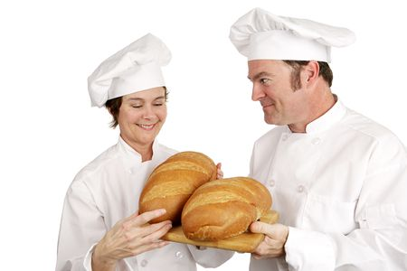 impressed: Mature female chef impressed with the baking of a student.  Isolated on white Stock Photo