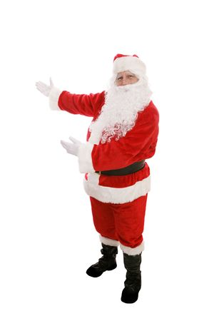 Full body view of Santa Claus with his arms raised in a presenting gesture.  Isolated on white.   Stock Photo