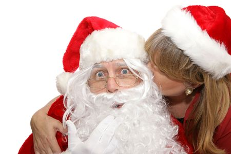 Santa surprised by a kiss from a female admirer.  White background.