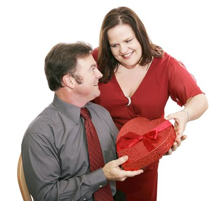 Woman giving her husband valentine chocolate.  Isolated on white. Stock Photo - 2094369