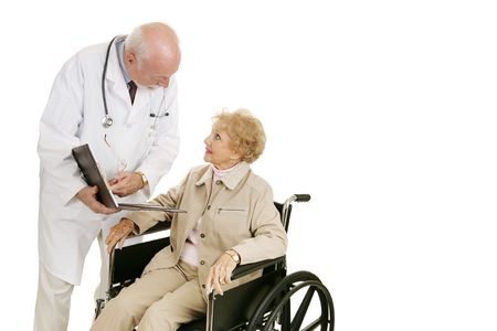 room for text: Disabled senior woman consults with her doctor.  Isolated with room for text.