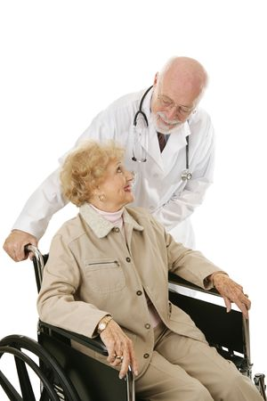 geriatrics: Disabled senior woman trusts her mature, kind doctor.  Isolated on white.