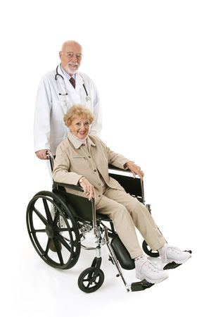 compassionate: Pretty senior woman in a wheelchair being pushed by her doctor.  Full body isolated on white.