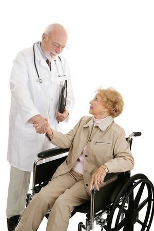 Mature doctor congratulates his disabled patient on a successful treatment.  Isolated on white.   photo
