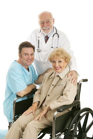 Senior lady in wheelchair with her doctor and nurse.  Isolated on white.