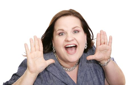 plus sized: Beautiful plus sized model holding her hands up in a gesture of surprise.  Isolated on white.   Stock Photo