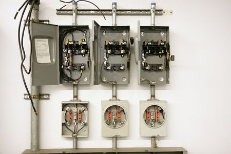 Industrial electrical meter center with multiple breaker panels.  They are disassembled to help train vocational education students.